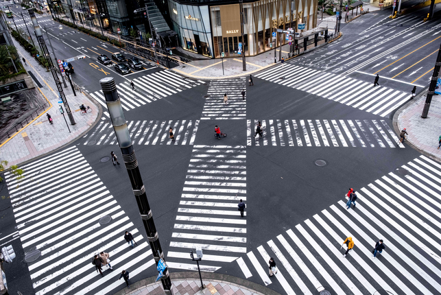 March 29, 2020. Few people cross a normally busy intersection after the Tokyo metropolitan government asked residents to stay home from the coronavirus.