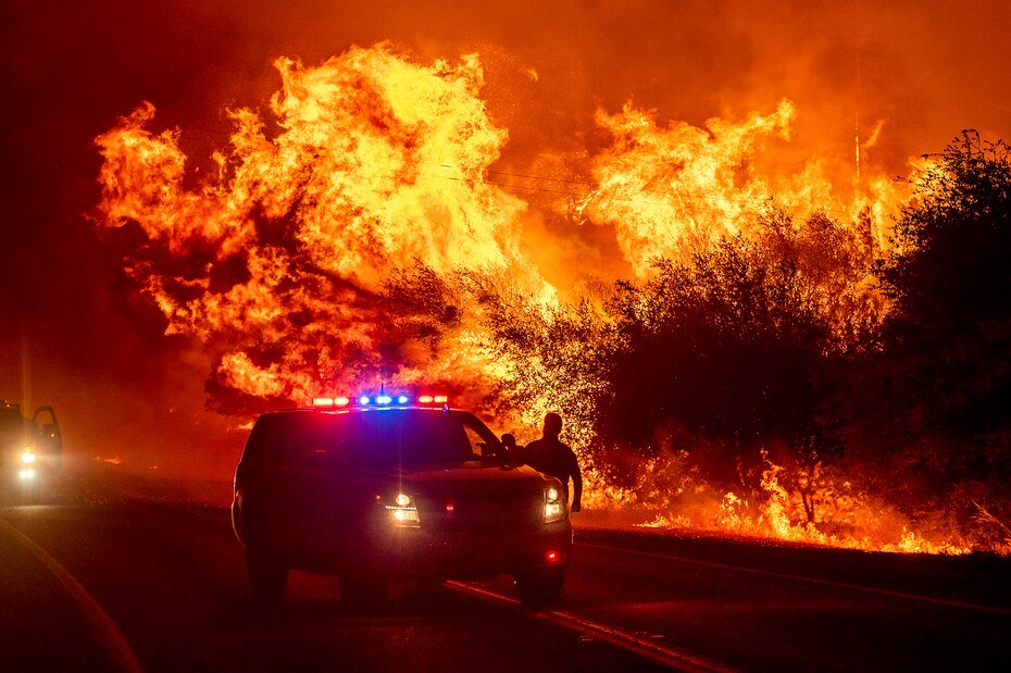 Wildfire flames illuminate Highway 162 in Oroville, California.
