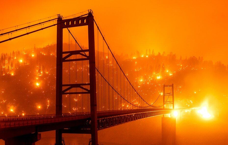 Wildfire flames behind Bidwell Bar Bridge in Oroville, California.