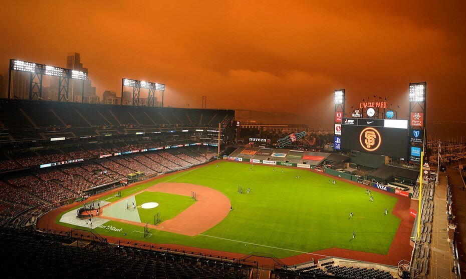 Smoke from the California wildfires paints the sky over Oracle Park during the Seattle Mariners batting practice prior to their MLB game against the San Francisco Giants.