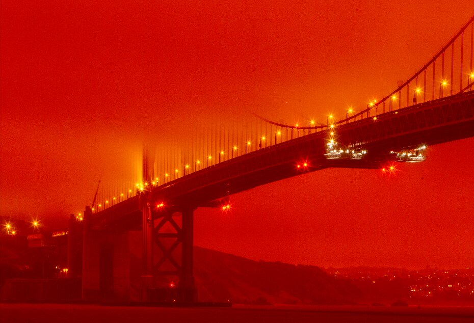 The Golden Gate Bridge under orange skies due to wildfires in San Francisco.