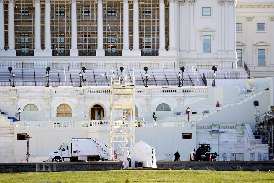 Maintenance workers cleaned the exterior of the Capitol, which the morning after Wednesday's violent riot looked peaceful.