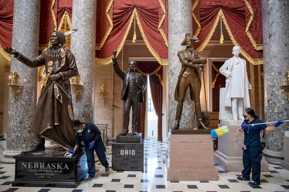 Employees cleaned the dust residue from the statuary pedestals in Statuary Hall, inside the Capitol.