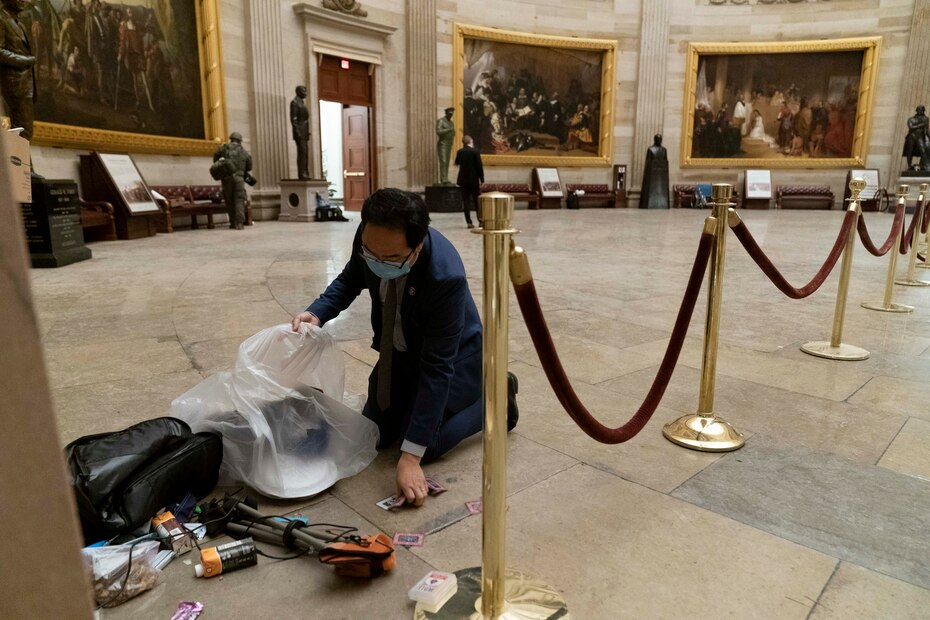 New Jersey Democratic Rep. Andy Kim joined efforts to clean up the Capitol rotunda early Thursday morning.