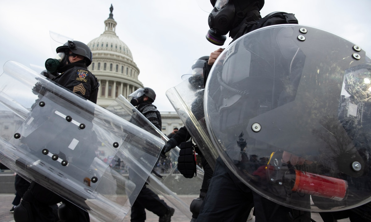 An active Navy officer is arrested for the assault on the federal Capitol