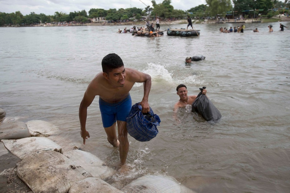 Migrants cross the Suchiate River on the Mexican side after crossing the border with Guatemala.