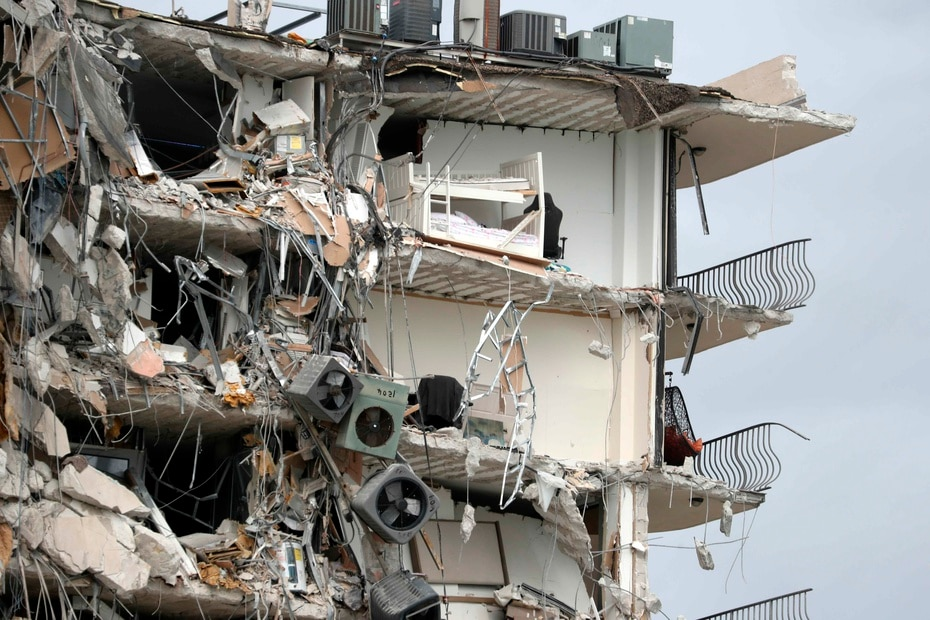 Articles, air conditioning consoles and beds are exposed after the partial collapse of the Champlain Towers South condominium in Miami.