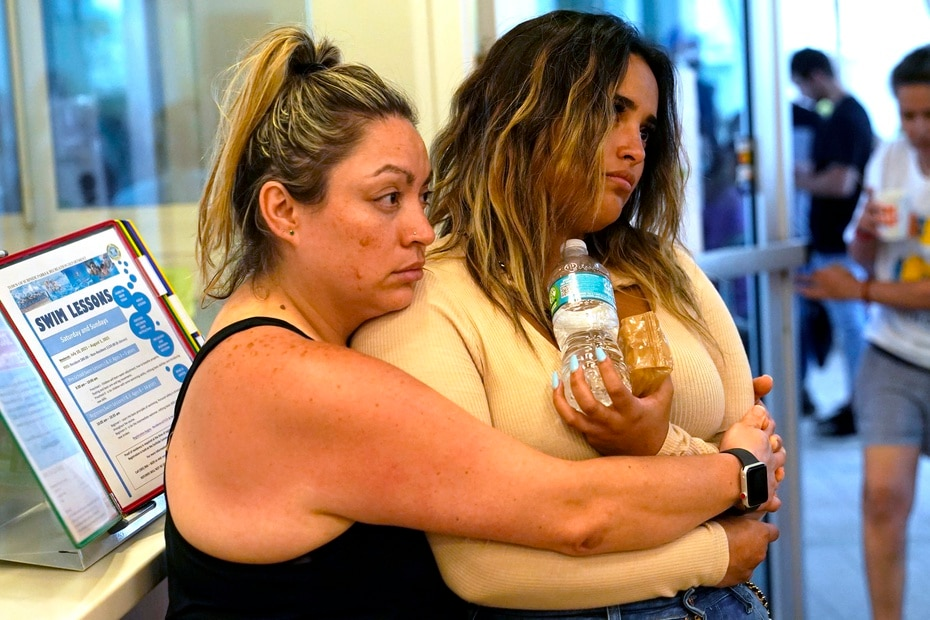 Andrea and Nellie Gonzalez wait for news of their relatives at the Family Reunification Center established near the area of the collapse.