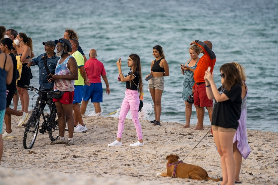 Relatives, friends and neighbors close to the place came to the beach near the structure to witness the search mission.