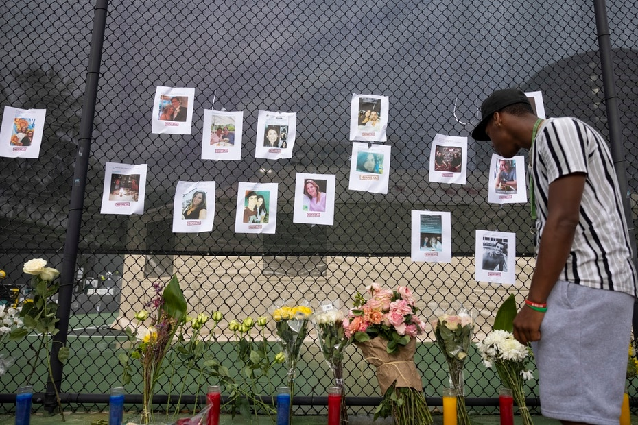 In the photo, a makeshift memorial near the scene where families have posted photos of their disappeared.