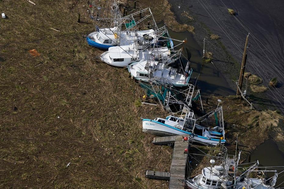 Boats hit by powerful Ida winds in Lafitte, Louisiana.