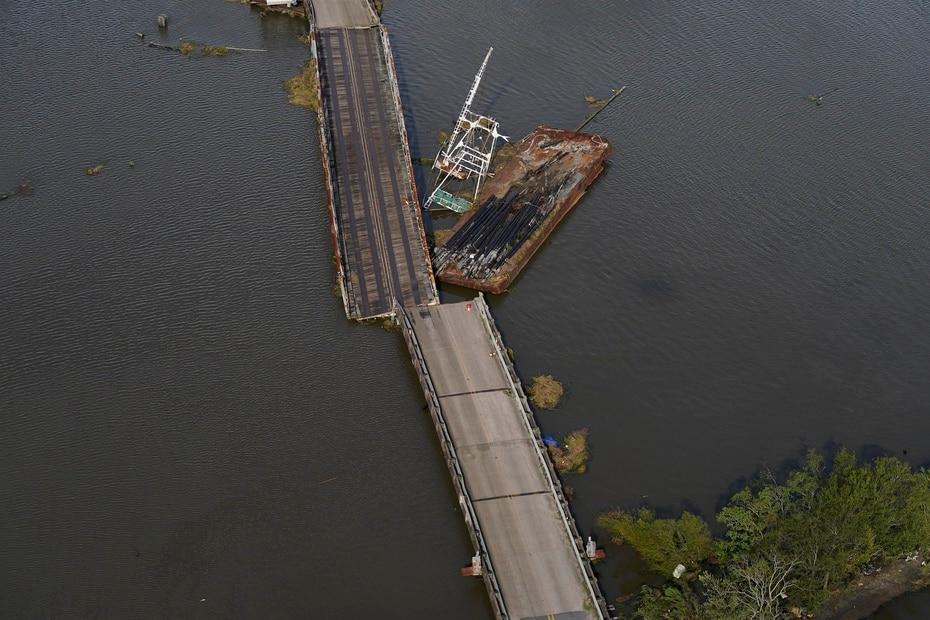 A barge damages a bridge that divides two Louisiana cities.