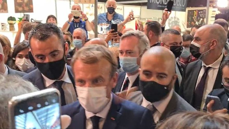 An egg is thrown at Macron at a gastronomy fair in Lyon